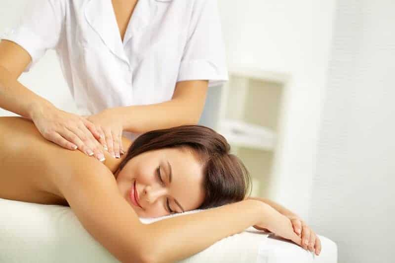 Woman getting a shoulder massage
