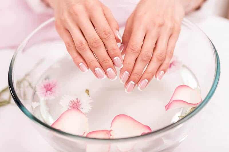 Beautiful hands receiving a manicure
