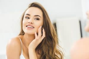 Woman smiling after dermaplaning